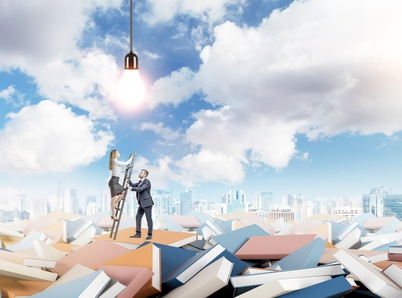 Young businesswoman climbing a ladder which is held for her by a young businessman on numerous scattered books. Bulb above. Blue sky an New York at the background. Concept of knowledge.